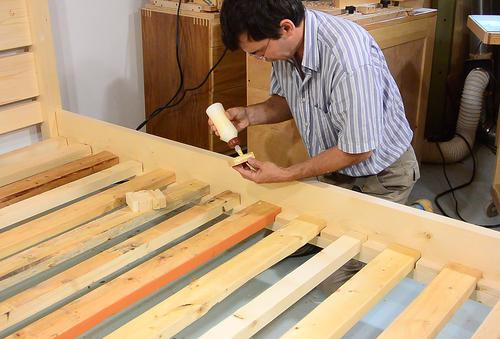 then adding the bed slats these span the full width of a queen size mattress 5 or 15 meters they are made from 2x4s and 2x3s mostly used wood i had